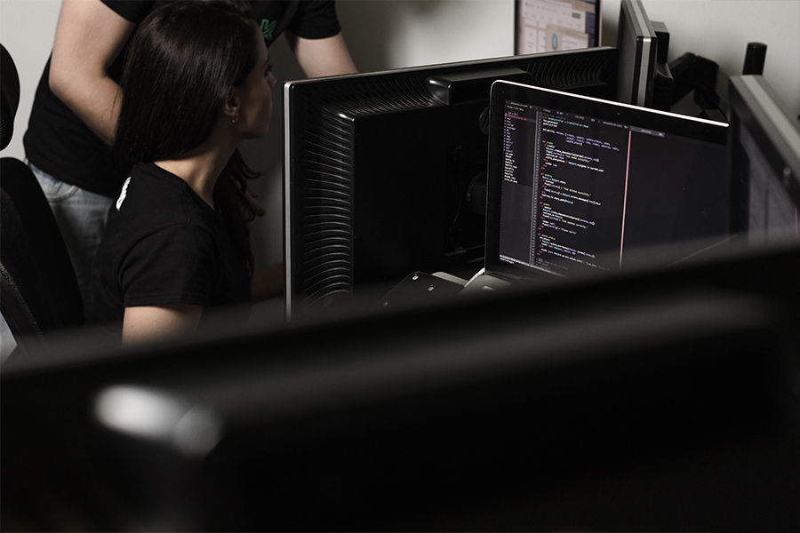 A member of our team working on her computer